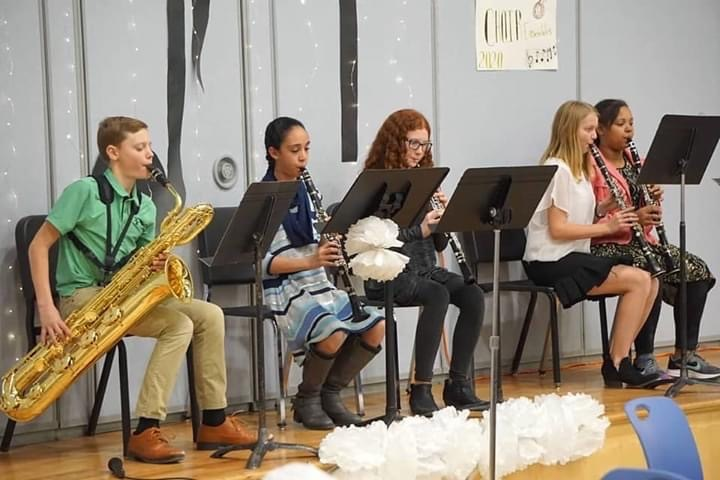 5 CCMS students playing their instruments